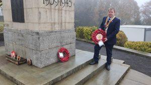 Councillor Holding A Wreath