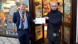Angelo receiving award from Mayor